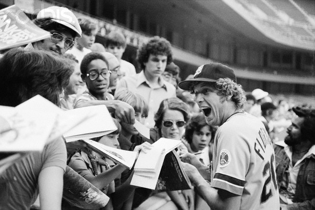Mark Fidrych exudes boyish enthusiasm while signing autographs